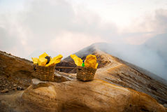 Baskets with sulphur at Kawah Ijen krater, Indonesia Stock Image