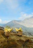 Baskets of sulphur in Kawah Ijen, a sulfur vulcano, East Java, I Stock Photos