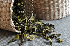 Baskets of tea leaves. A small basket of tea leaves in front of a larger basket Royalty Free Stock Photography