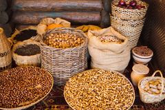 Baskets with various kinds of nuts. Market royalty free stock photo