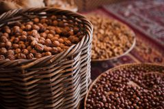 Baskets with various kinds of nuts. Market stock photo