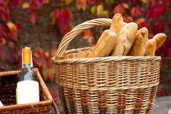 Baskets with wine and bread. Twobaskets with wine and bread in autumn background Stock Photos