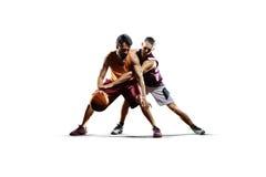 Basketspelare i handling som isoleras på vit Arkivfoton