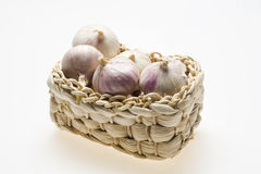 Baskett with much garlic Stock Photos