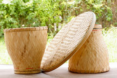 Basketwork contains earthenware steamer and threshing basket. Royalty Free Stock Image