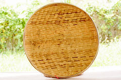 Basketwork contains earthenware steamer and threshing basket. Stock Image