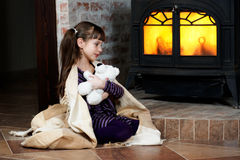 Warming up by the Fireplace Royalty Free Stock Images