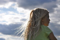 Basking In The Sunshine. Inspirational closeup of a pretty little girl daydreaming outside Stock Images