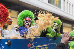 Basel carnival 2016 37. Some disguised children on a typical carnival car throw huge amounts of confetti onto the watching crowd during the basel carnival 2016 Royalty Free Stock Photos