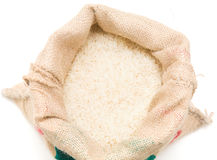 Basmati. Fine long-grained basmati rice in a burlap sack, square crop Stock Images