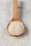 Basmati rice. Bunch of white basmati rice on a wooden spoon Stock Photos
