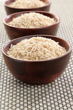 Basmati rice. Several bowls of healthy organic basmati rice Royalty Free Stock Images