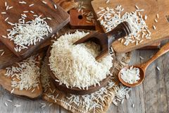 Basmati rice in a bowl with a spoon. Close up Stock Images