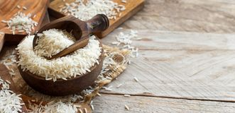 Basmati rice in a bowl with a spoon. Close up Royalty Free Stock Photography