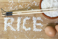 Basmati rice with chopsticks and two brown eggs Royalty Free Stock Photography