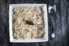 Basmati rice. With classic long grains, cooked in Indian style with cumin seeds and topped with a bayleaf Stock Photos
