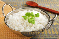 Basmati Rice with Coriander Leaf. Basmati rice, perfectly cooked, in a steel karahi with a garnish or coriander Royalty Free Stock Photos