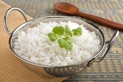Basmati Rice with Coriander Leaf. Basmati rice, perfectly cooked, in a steel karahi with a garnish or coriander royalty free stock images