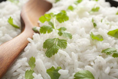 Basmati Rice and Coriander with Spoon Close-up Stock Images