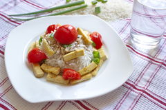 Basmati rice with pieces of roasted tofu, tomatoes and onion Stock Photo