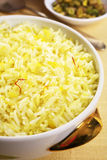 Basmati Rice with Saffron. Bowl of basmati rice flavoured with saffron, ghee and fresh stock Stock Photography