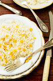 Basmati rice in white plate witn sweet corn Stock Photos