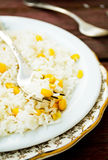 Basmati rice in white plate witn sweet corn Royalty Free Stock Photos