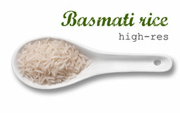 Basmati rice in white porcelain spoon Royalty Free Stock Photography