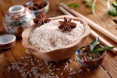 Basmati rice in wooden bowl Stock Photo