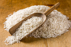 Basmati rice. Wooden scoop with basmati rice Stock Photos