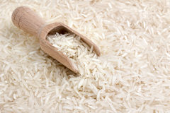Basmati rice and wooden scoop Royalty Free Stock Images