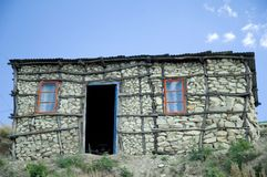Basotho Hut 1. A Traditional stone and woodframe Basotho house with brightly coloured outline of windows and door frames Stock Photo