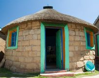 Basotho Hut 1. A Traditional sandstone Basotho rondavel with pastel coloured outline of windows and door frames Royalty Free Stock Images