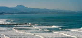Basque Coast Beach in Biarritz in France. Basque Coast Beach and Mountains in Biarritz in France stock photography