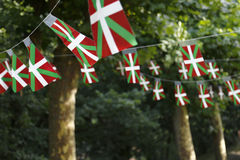 Basque country flags. Basque country flags flying in a park with trees stock photos