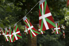 Basque country flags. Basque country flags flying in a park with trees Stock Photo