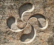 Basque cross. Symbol engraved in stone called lauburu royalty free stock images