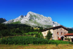 Basque farmhouse under Anboto mountain in Basque Country Royalty Free Stock Image