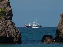 Two Basque fishing boats crossing the rocks of Laga. Basque fishing boats crossing the rocks on the way to Bermeo en Laga. Bizkaia Basque Country Stock Photos