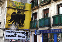 Basque nationalist mural. A mural depicting the black eagle (Nasque: Arrano beltza), an ancient Basque and Navarre symbol which shows a black eagle upon a yellow Royalty Free Stock Photo