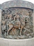 Basrelief av monumentet i fyrkanten arkivfoto