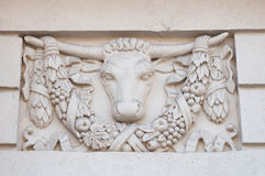 Basrelief on the facade of a historic building with bull head Stock Photos