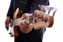 Bass. A man playing electrical bass Royalty Free Stock Images