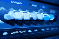 Bass Amp Equalizer. Equalization control panel of a bass amplifier with selective focus on the High Mid tuner knob Royalty Free Stock Photo