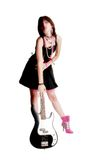 Bass Babe. Teen girl standing with electric bass guitar.  Shot in studio over white Stock Image