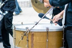 Bass drum band musician walking in the street. During a celebration on blur background Royalty Free Stock Images