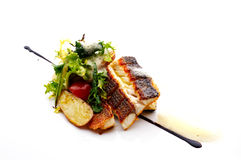 Bass fish fillet. With potato and green salad royalty free stock image