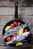 Bass fish in the pan Stock Photography