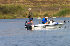 Bass Fishing Men Boat Dam Stockbild