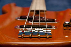 Bass guitar. A bass guitar closeup photo stock images